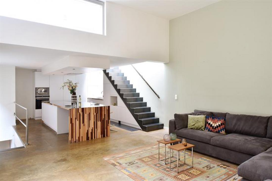Uniek achterhuis met terrassen en garage