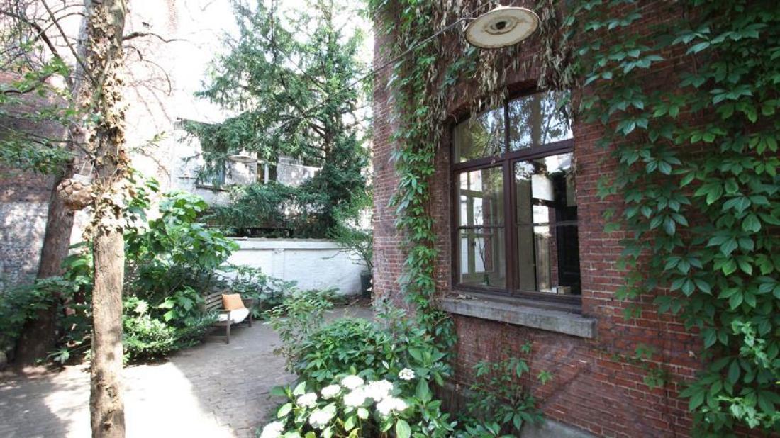 Verborgen parel: duplex met tuin in achterhuis